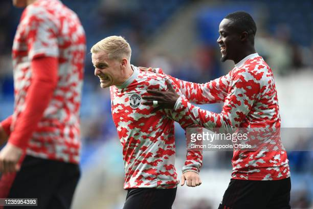 Eric Bailly of Manchester United and Donny van de Beek of Manchester United share a joke before the Premier League match between Leicester City and...