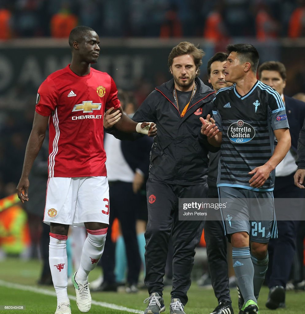 Eric Bailly of Manchester United and Facundo Roncaglia of Celta Vigo walk off after being sent off during the UEFA Europa League, semi final second leg match, between Manchester United and Celta Vigo at Old Trafford on May 11, 2017 in Manchester, United Kingdom.