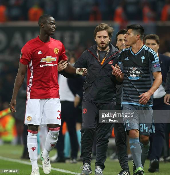 Eric Bailly of Manchester United and Facundo Roncaglia of Celta Vigo walk off after being sent off during the UEFA Europa League semi final second...