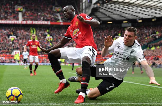 Eric Bailly of Manchester United and James Milner of Liverpool clash during the Premier League match between Manchester United and Liverpool at Old...