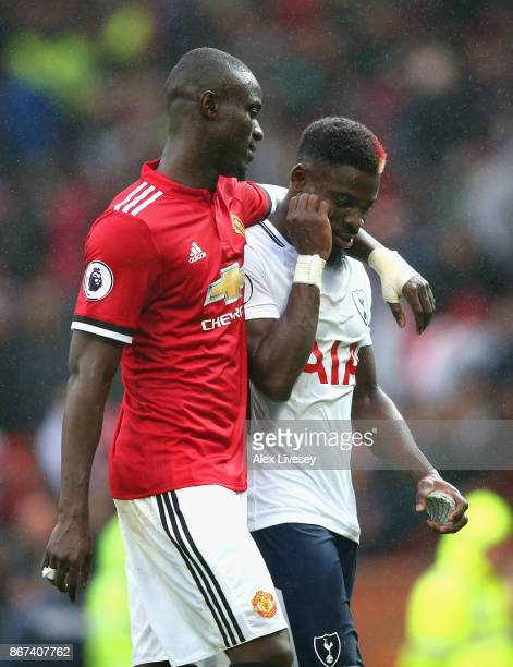 Eric Bailly of Manchester United and Serge Aurier of Tottenham Hotspur embrace after the Premier League match between Manchester United and Tottenham...
