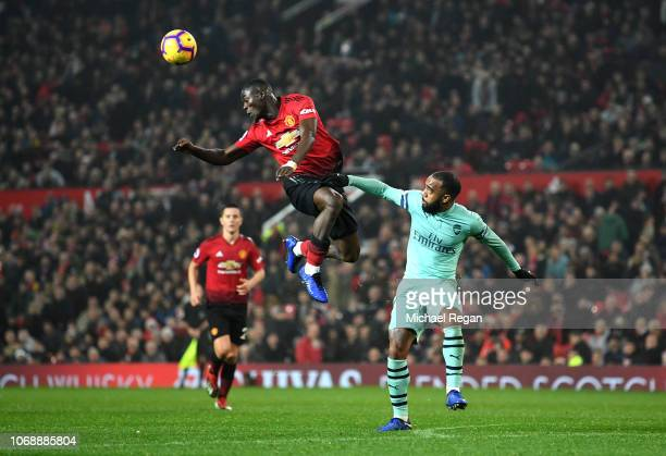 Eric Bailly of Manchester United battles for possession with Alexandre Lacazette of Arsenal during the Premier League match between Manchester United...