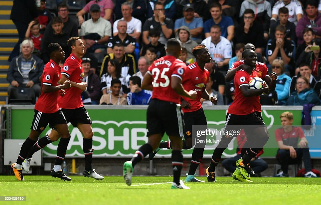 Eric Bailly of Manchester United celebrates scoring his sides first goal with his Manchester Untited team mates during the Premier League match between Swansea City and Manchester United at Liberty Stadium on August 19, 2017 in Swansea, Wales.