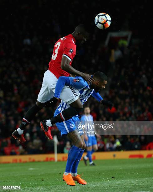 Eric Bailly of Manchester United challenges Jurgen Locadia of Brighton during the Emirates FA Cup Quarter Final between Manchester United and...
