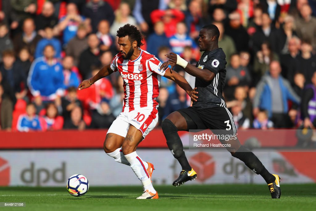 Eric Bailly of Manchester United chases down Maxim Choupo-Moting of Stoke City during the Premier League match between Stoke City and Manchester United at Bet365 Stadium on September 9, 2017 in Stoke on Trent, England.