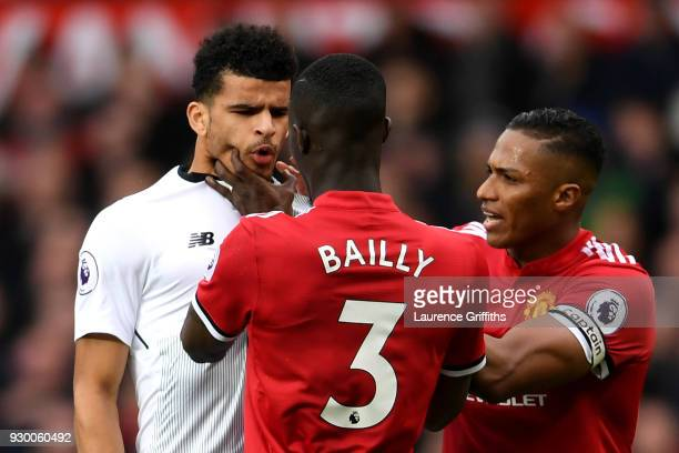 Eric Bailly of Manchester United clahses with Dominic Solanke of Liverpool during the Premier League match between Manchester United and Liverpool at...