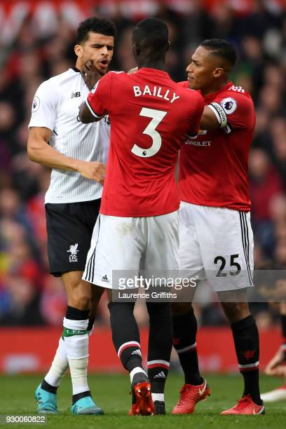 Eric Bailly of Manchester United clashes with Dominic Solanke of Liverpool during the Premier League match between Manchester United and Liverpool at...
