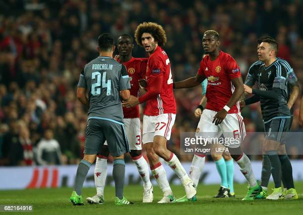 Eric Bailly of Manchester United clashes with Facundo Roncaglia of Celta Vigo during the Uefa Europa League semi final second leg match between...
