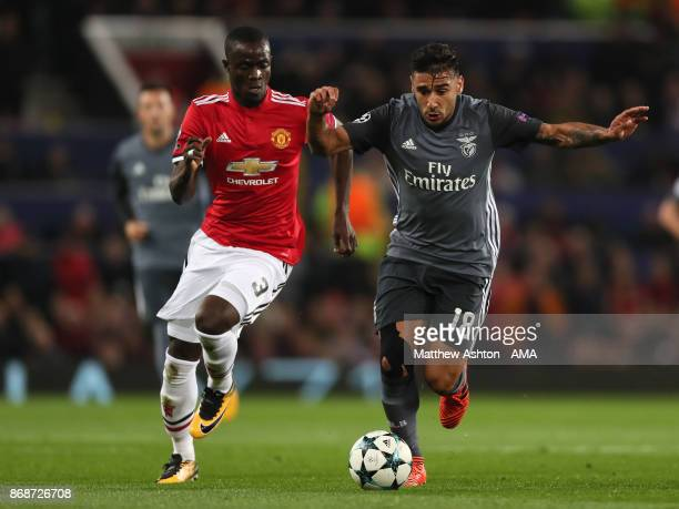 Eric Bailly of Manchester United competes with Eduardo Salvio of Benfica during the UEFA Champions League group A match between Manchester United and...