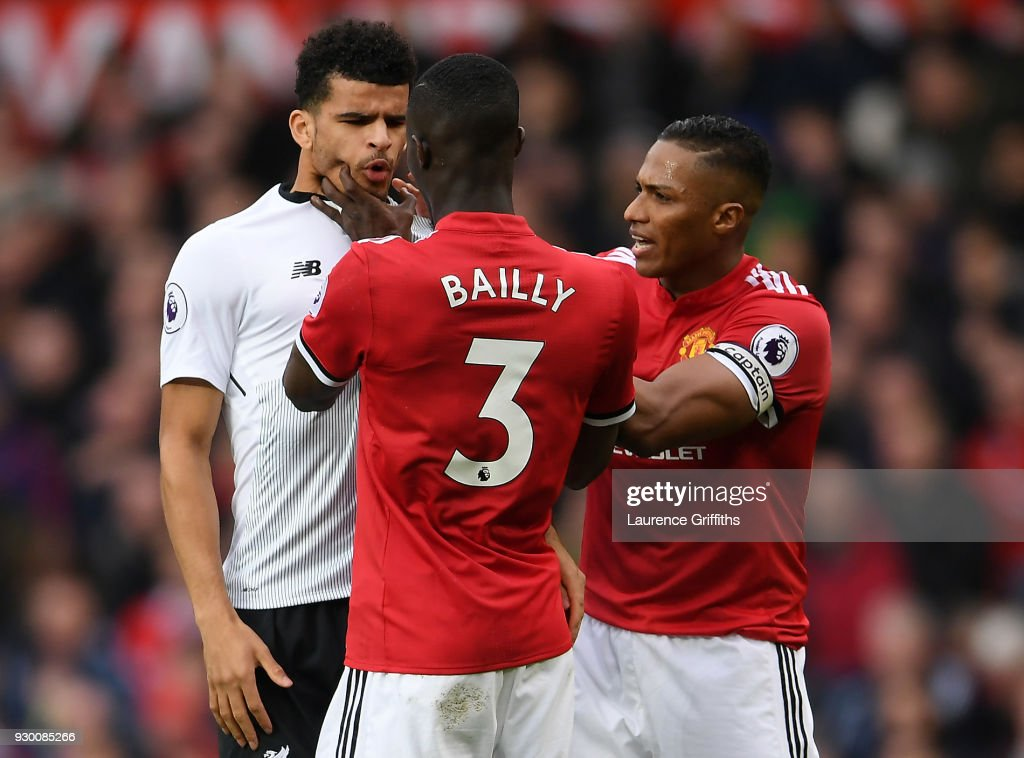 Eric Bailly of manchester United grabs the face of Dominic Solanke of Liverpool during the Premier League match between Manchester United and Liverpool at Old Trafford on March 10, 2018 in Manchester, England.