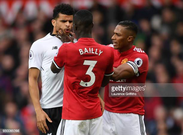 Eric Bailly of manchester United grabs the face of Dominic Solanke of Liverpool during the Premier League match between Manchester United and...