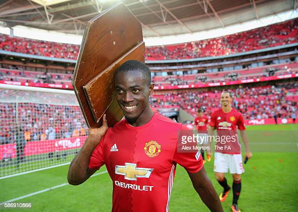 Eric Bailly of Manchester United holds the Community Shield during The FA Community Shield match between Leicester City and Manchester United at...
