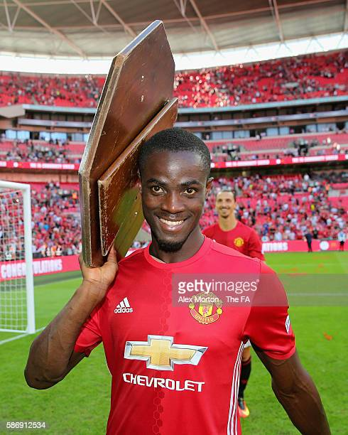Eric Bailly of Manchester United holds the Community Shield trophy on his shoulder after the final whistle during The FA Community Shield match...