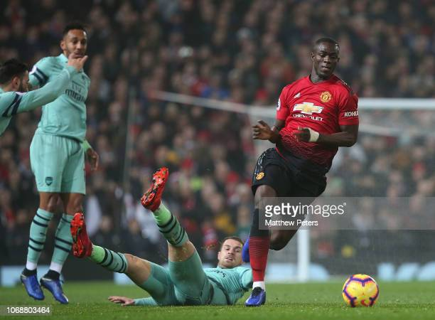 Eric Bailly of Manchester United in action with Aaron Ramsey of Arsenal during the Premier League match between Manchester United and Arsenal FC at...