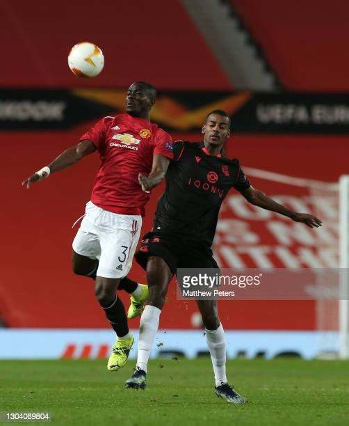 Eric Bailly of Manchester United in action with Alexander Isak of Real Sociedad during the UEFA Europa League Round of 32 match between Manchester...