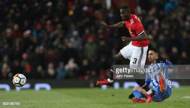 Eric Bailly of Manchester United in action with Beram Kayal of Brighton Hove Albion during the Emirates FA Cup Quarter Final match between Manchester...