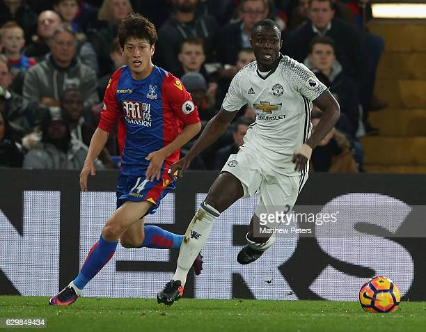 Eric Bailly of Manchester United in action with Chung-Yong Lee of Crystal Palace during the Premier League match between Crystal Palace and...