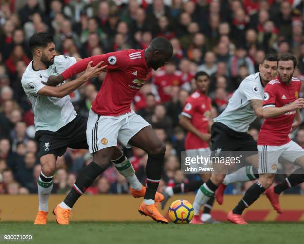 Eric Bailly of Manchester United in action with Emre Can of Liverpool during the Premier League match between Manchester United and Liverpool at Old...