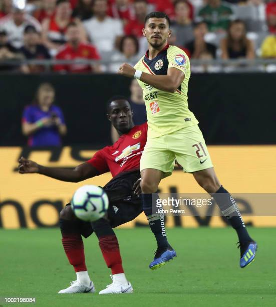 Eric Bailly of Manchester United in action with Henry Martin of Club America during the preseason friendly match between Manchester United and Club...