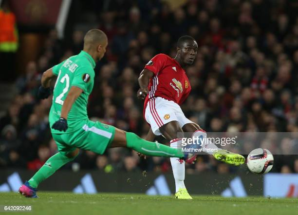 Eric Bailly of Manchester United in action with Kevin MonnetPaquet of AS SaintEtienne during the UEFA Europa League Round of 32 first leg match...