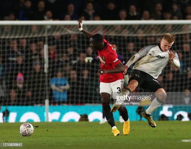 Eric Bailly of Manchester United in action with Louie Sibley of Derby County during the FA Cup Fifth Round match between Derby County and Manchester...