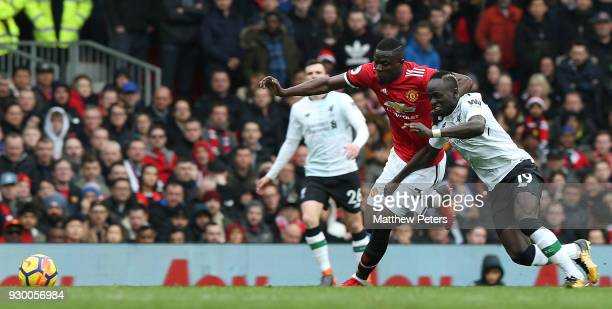 Eric Bailly of Manchester United in action with Sadio Mane of Liverpool during the Premier League match between Manchester United and Liverpool at...