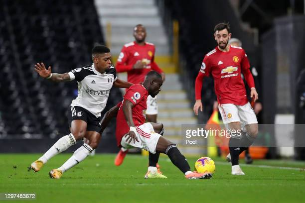 Eric Bailly of Manchester United is challenged by Ivan Cavaleiro of Fulham during the Premier League match between Fulham and Manchester United at...