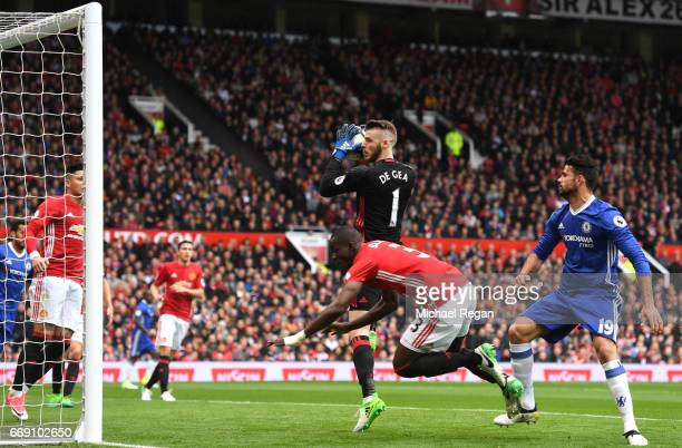Eric Bailly of Manchester United is fouled by Diego Costa of Chelsea as David De Gea of Manchester United collects the ball during the Premier League...