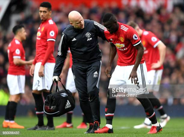 Eric Bailly of Manchester United is given assistance during the Premier League match between Manchester United and Liverpool at Old Trafford on March...