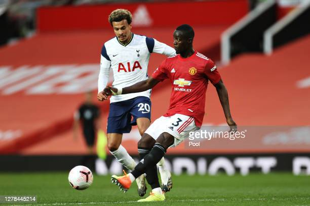 Eric Bailly of Manchester United is put under pressure by Dele Alli of Tottenham Hotspur during the Premier League match between Manchester United...