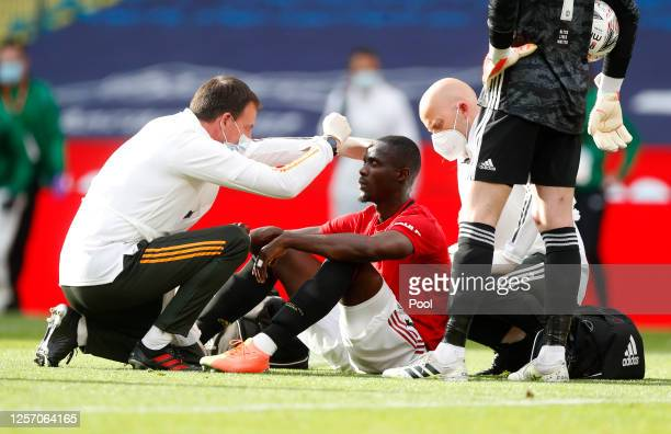 Eric Bailly of Manchester United is seen to by medical staff after a collision during the FA Cup Semi Final match between Manchester United and...