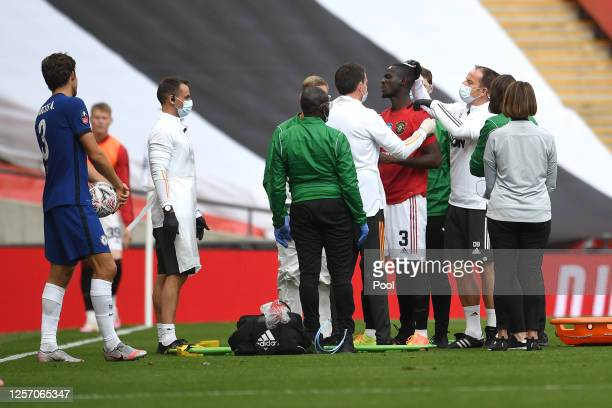 Eric Bailly of Manchester United is seen to by medical staff after a head collision during the FA Cup Semi Final match between Manchester United and...