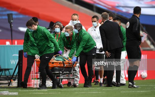 Eric Bailly of Manchester United is seen to by medical staff after a head collision and is stretchered off the pitch during the FA Cup Semi Final...