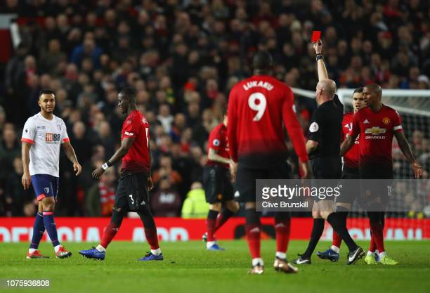Eric Bailly of Manchester United is shown a red card and is sent off by referee Lee Mason during the Premier League match between Manchester United...
