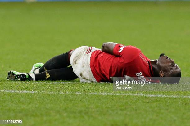 Eric Bailly of Manchester United lies on the turf with cramp during a pre-season friendly match between Manchester United and Leeds United at Optus...