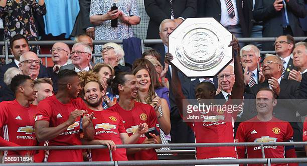 Eric Bailly of Manchester United lifts the Community Shield trophy after the FA Community Shield match between Leicester City and Manchester United...