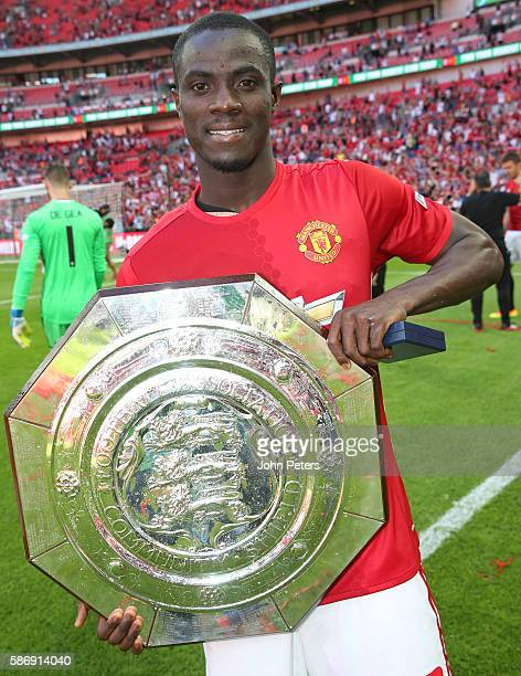 Eric Bailly of Manchester United pose with the Community Shield trophy after the FA Community Shield match between Leicester City and Manchester...