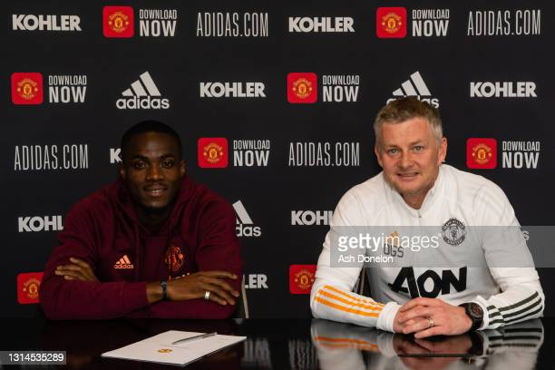 Eric Bailly of Manchester United poses with Manager Ole Gunnar Solskjaer after signing a contract extension at Aon Training Complex on April 26, 2021...