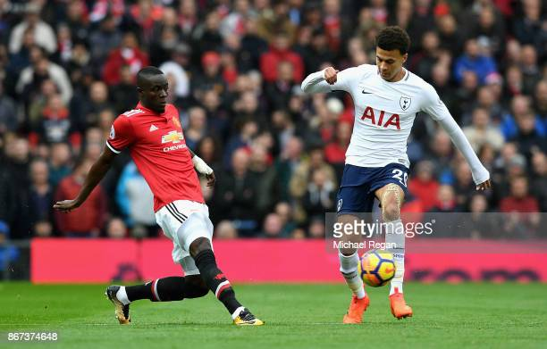 Eric Bailly of Manchester United puts pressure on Dele Alli of Tottenham Hotspur during the Premier League match between Manchester United and...