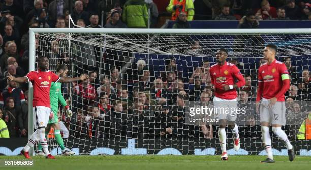 Eric Bailly of Manchester United reacts to conceding a second goal during the UEFA Champions League Round of 16 Second Leg match between Manchester...