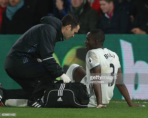 Eric Bailly of Manchester United receives treatment on a knee injury during the Premier League match between Crystal Palace and Manchester United at...