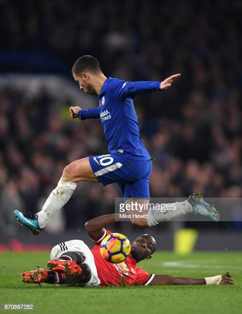 Eric Bailly of Manchester United tackles Eden Hazard of Chelsea during the Premier League match between Chelsea and Manchester United at Stamford...