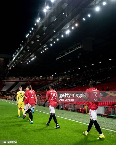 Eric Bailly of Manchester United walks out to the pitch with his team-mates prior to the UEFA Europa League Round of 32 match between Manchester...