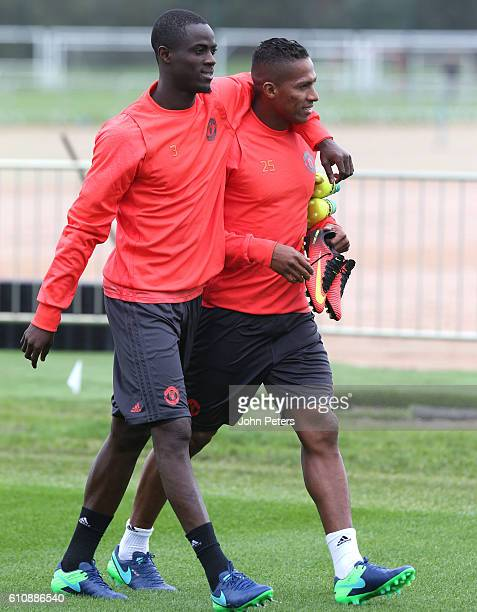 Eric Bailly of Manchester United walks with Antonio Valencia during a Manchester United Training session at Aon Training Complex on September 28,...