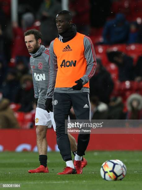 Eric Bailly of Manchester United warms up ahead of the Emirates FA Cup Quarter Final match between Manchester United and Brighton Hove Albion at Old...