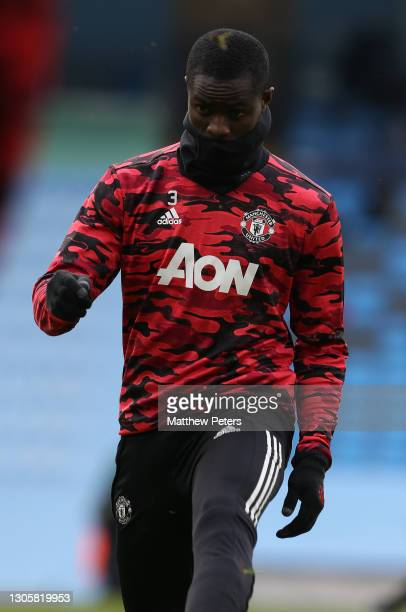 Eric Bailly of Manchester United warms up ahead of the Premier League match between Manchester City and Manchester United at Etihad Stadium on March...