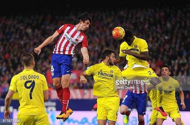 Eric Bailly of Villarreal CF clears the ball beside Stefan Savic of Club Atletico de Madrid during the La Liga match between Club Atletico de Madrid...