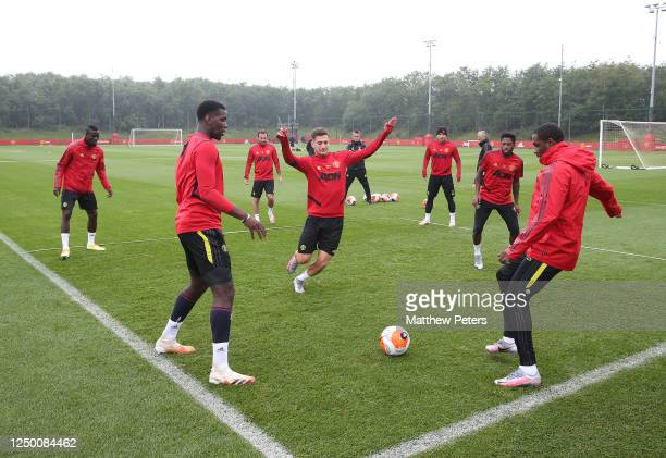 Eric Bailly Paul Pogba Juan Mata Diogo Dalot Luke Shaw Fred Odion Ighalo of Manchester United in action during a first team training session at Aon...