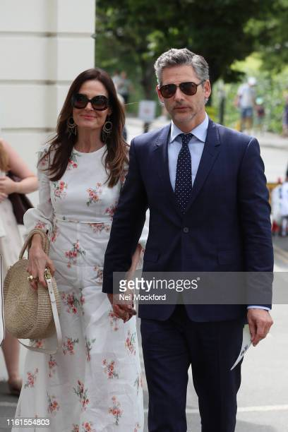 Eric Bana and Rebecca Gleeson attend day 11 the Mens semifinals at the Wimbledon 2019 Tennis Championships at All England Lawn Tennis and Croquet...