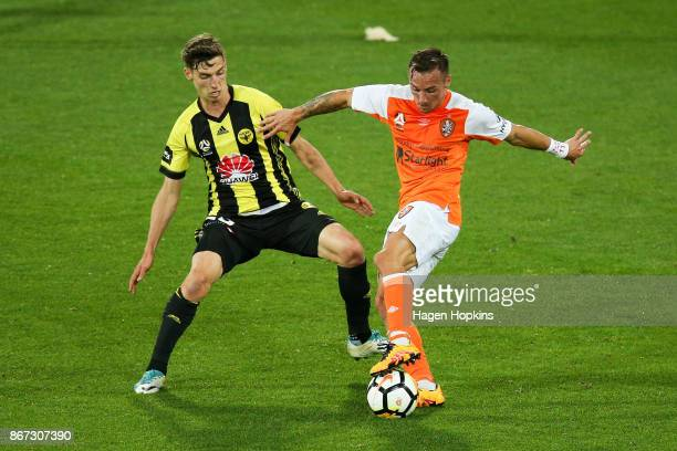 Eric Bautheac of Brisbane is challenged by Matthew Ridenton of the Phoenix during the round four ALeague match between the Wellington Phoenix and the...